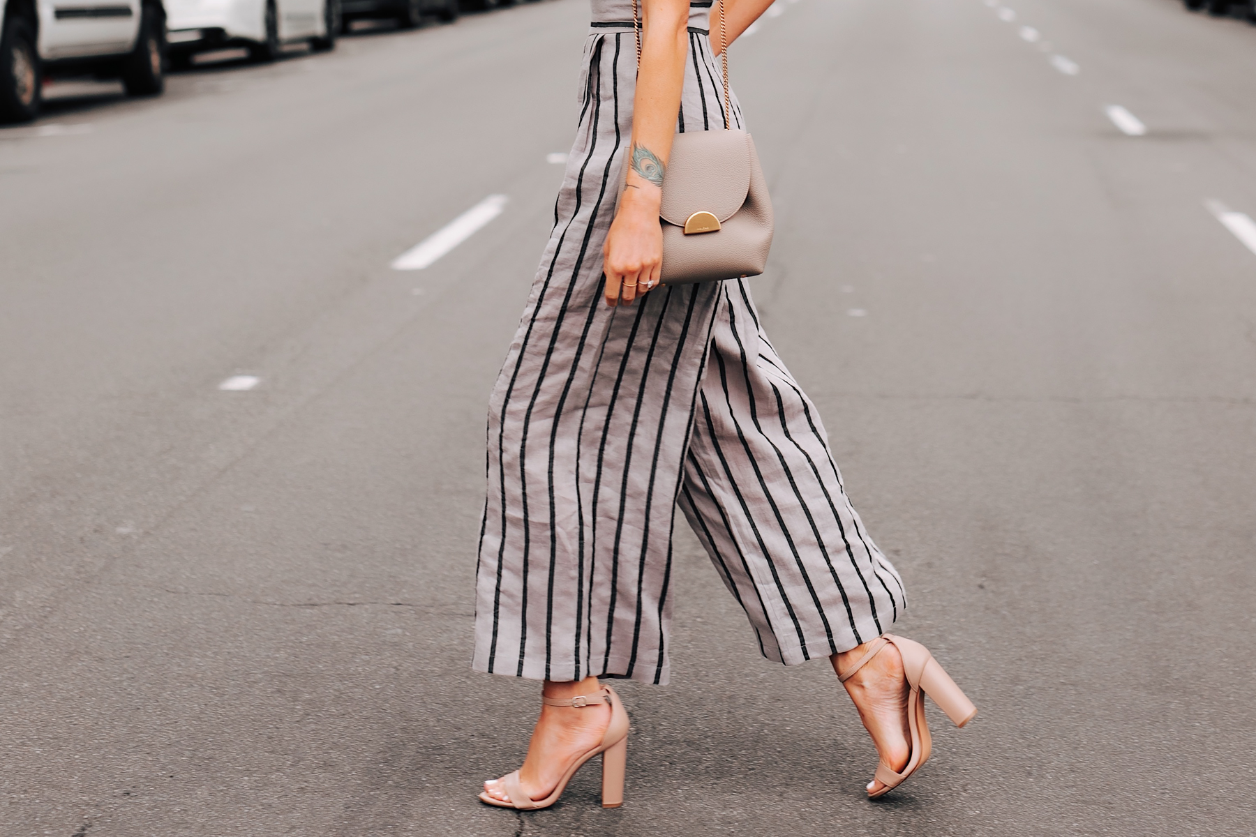 Woman Wearing Jing Grey Strapless Stripe Jumpsuit Tan Ankle Strap Heeled Sandals Grey Shoulder Handbag Fashion Jackson San Diego Fashion Blogger Street Style