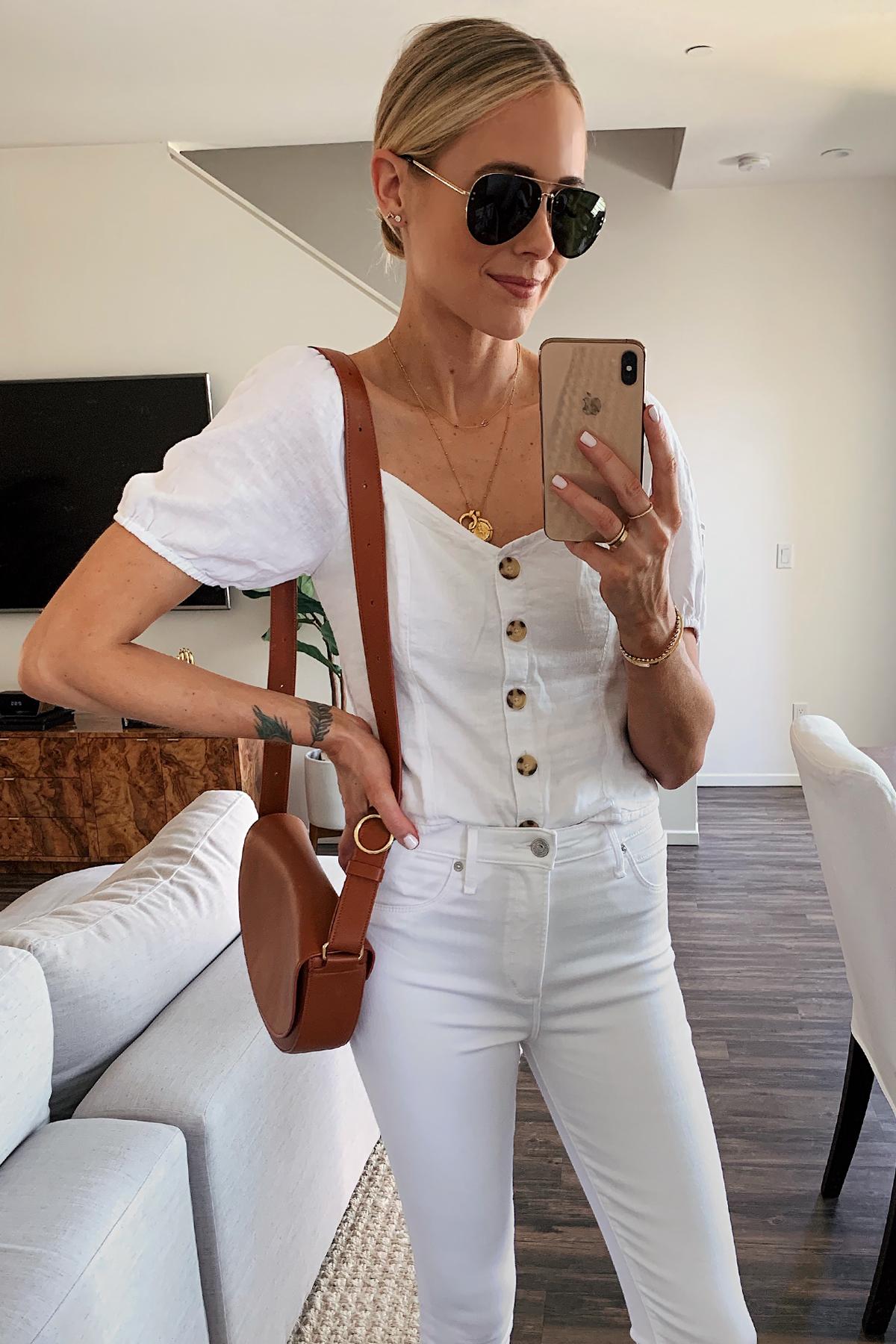 Fashion Jackson Wearing White Button Front Top White Skinny Jeans Tan Handbag Aviator Sunglasses