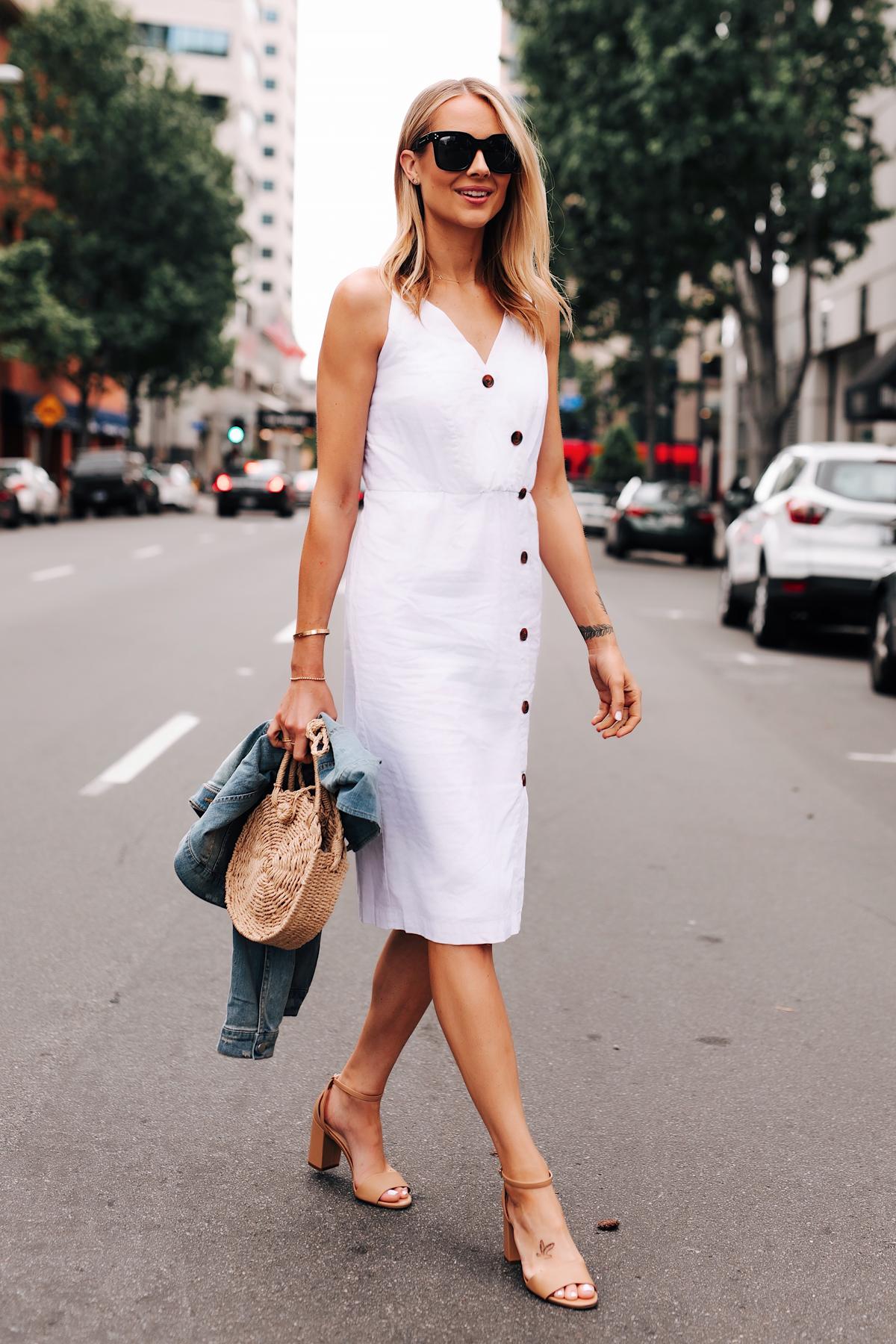Blonde Woman Wearing White Midi Dress Tan Ankle Strap Heeled Sandals Straw Circle Handbag Denim Jacket Fashion Jackson San Diego Fashion Blogger Street Style