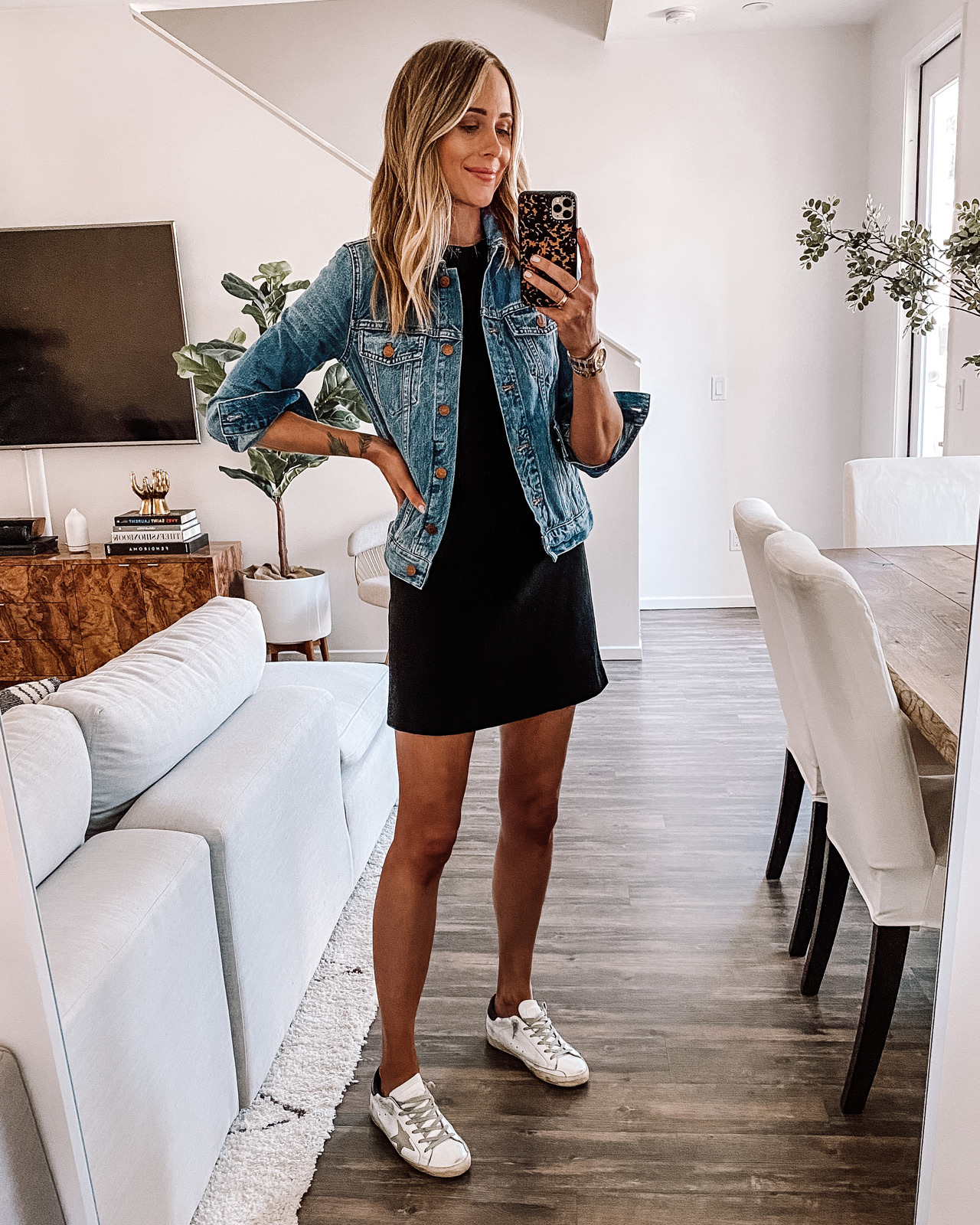 Fashion Jackson Wearing Black Mini Dress Denim Jacket Golden Goose Sneakers Outfit