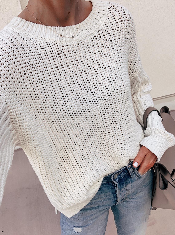 fashion jackson wearing oversized white sweater