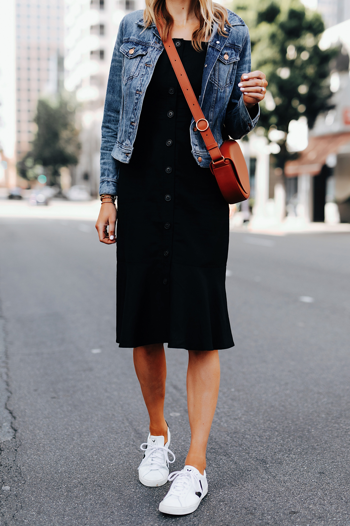 Fashion Jackson Wearing Banana Republic Black Button Front Dress Denim Jacket Tan Crossbody Handbag White Sneakers