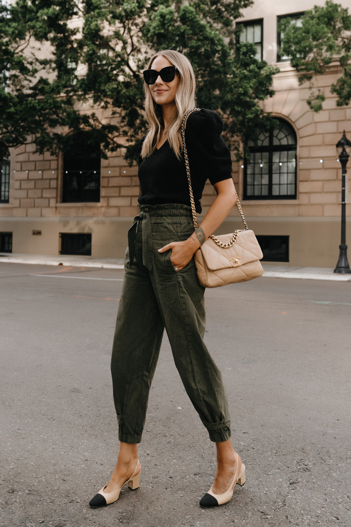 Fashion Jackson Wearing Black Puff Sleeve Sweater Olive Green Trousers Chanel 19 Beige Handbag Chanel Slingbacks Street Style non jeans work outfit for women