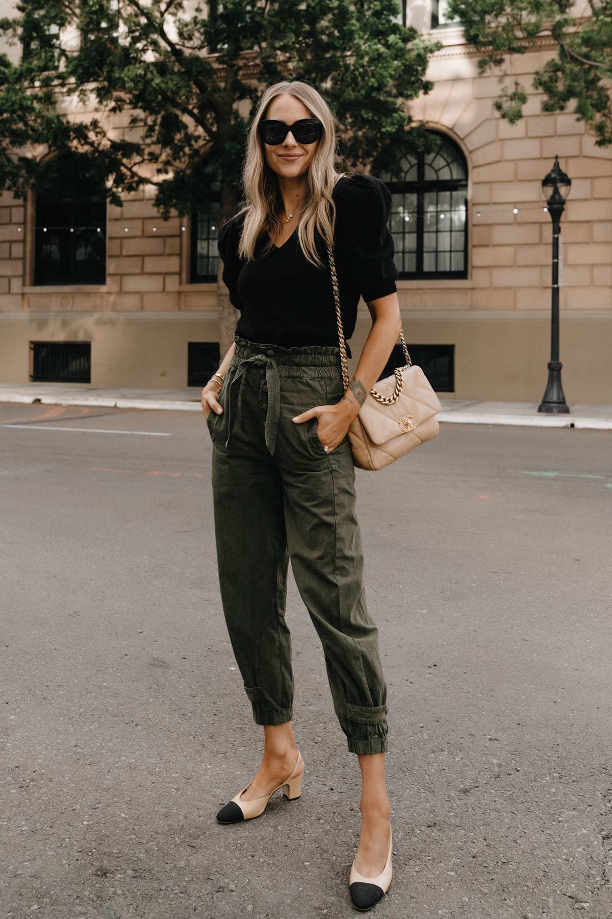 Fashion Jackson Wearing Black Puff Sleeve Sweater Olive Green Trousers Chanel 19 Beige Handbag Chanel Slingbacks non jeans work outfit for women 1