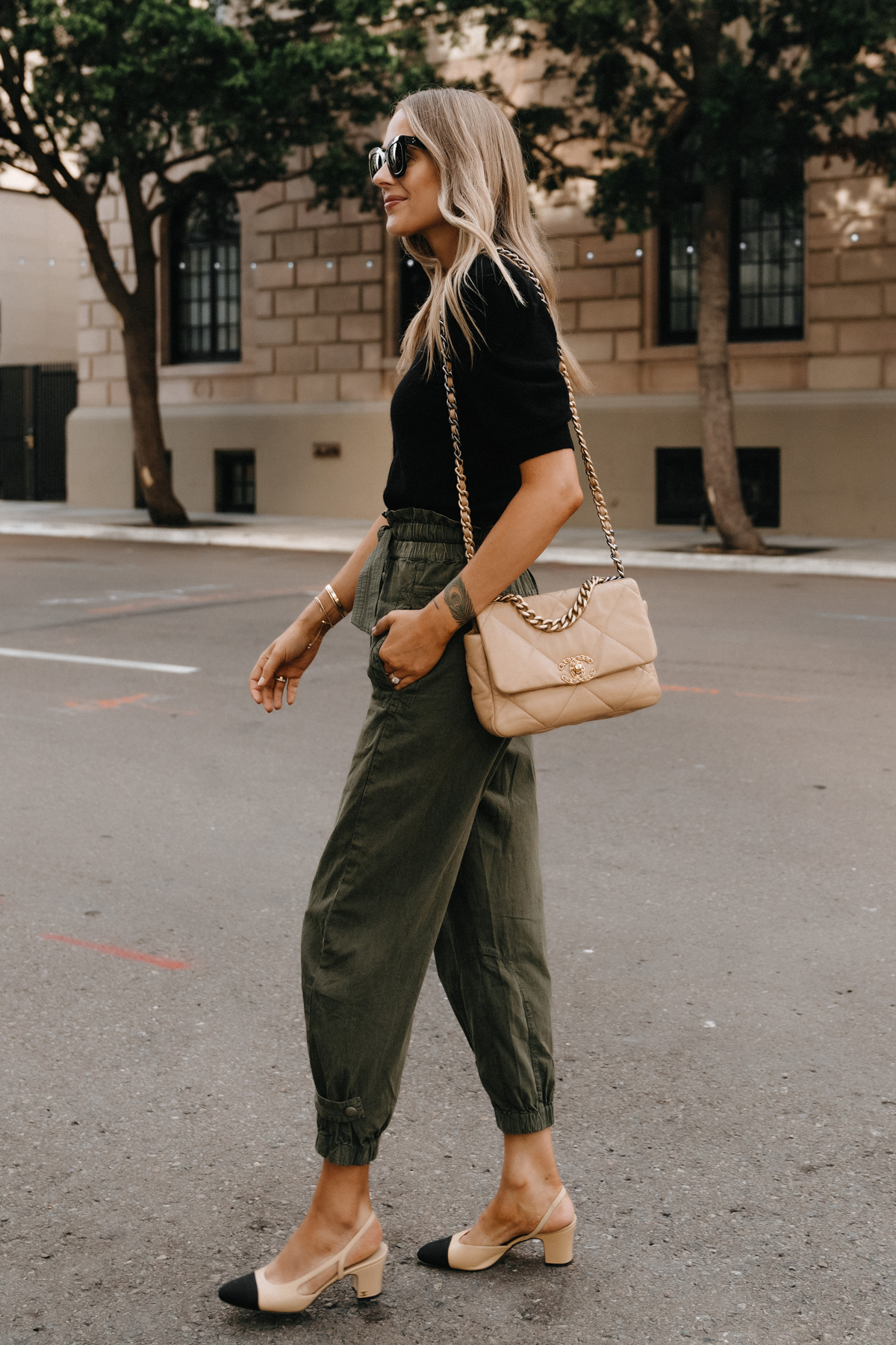 Fashion Jackson Wearing Black Puff Sleeve Sweater Olive Green Trousers Chanel 19 Beige Handbag Chanel Slingbacks non jeans work outfit for women