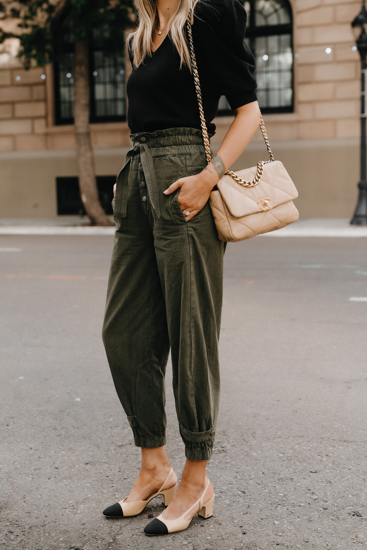 Fashion Jackson Wearing Black Puff Sleeve Sweater Olive Green Trousers Chanel Slingbacks non jeans work outfit for women