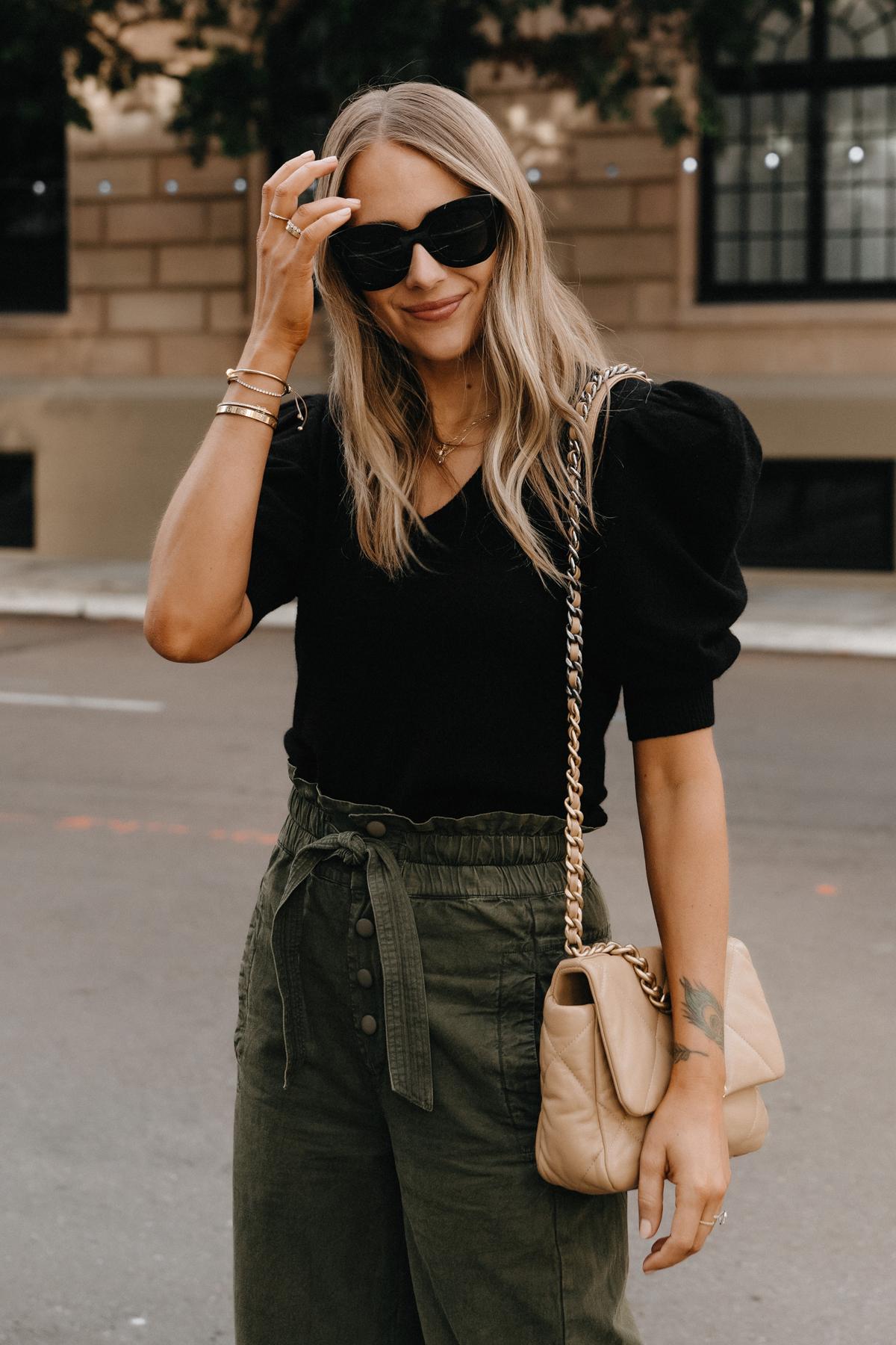 Fashion Jackson Wearing Black Puff Sleeve Sweater Olive Green Trousers