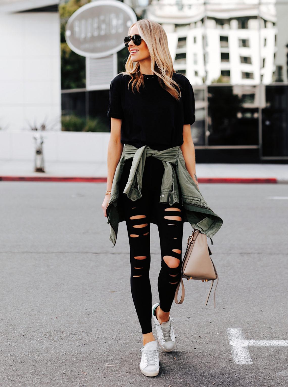 Fashion Jackson Wearing Black Tshirt Alo Black Ripped Warrior Leggings Green Utility Jacket Golden Goose Sneakers Celine Mini Belt Bag Featured Image