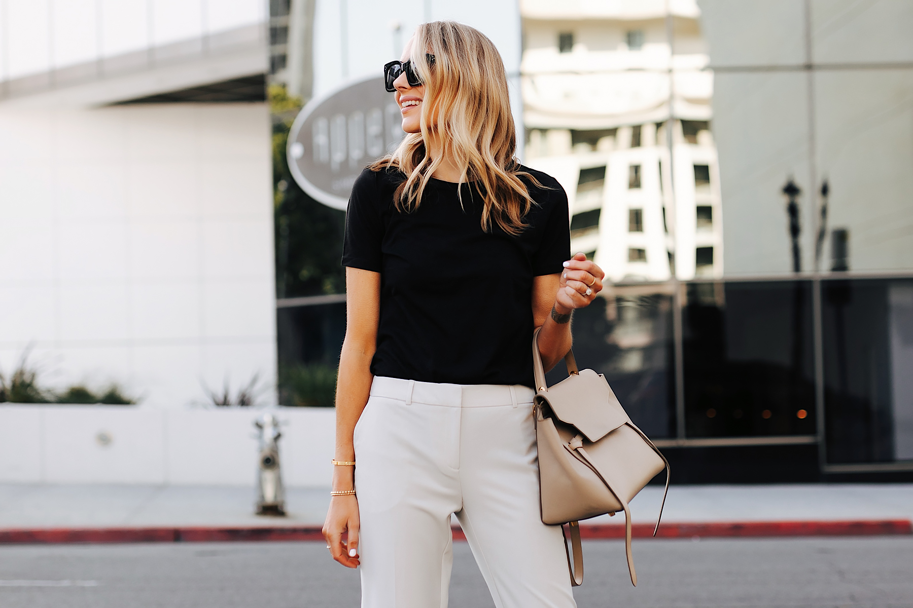 Fashion Jackson Wearing Black Tshirt Beige Trousers Celine Belt Bag