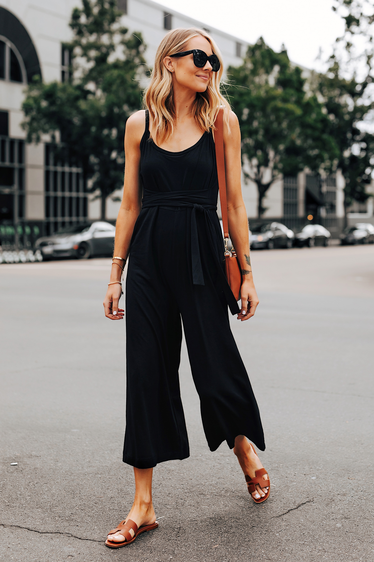 Fashion Jackson Wearing Cuyana Black Jumpsuit Hermes Oran Gold Sandals Cuyana Tan Crossbody