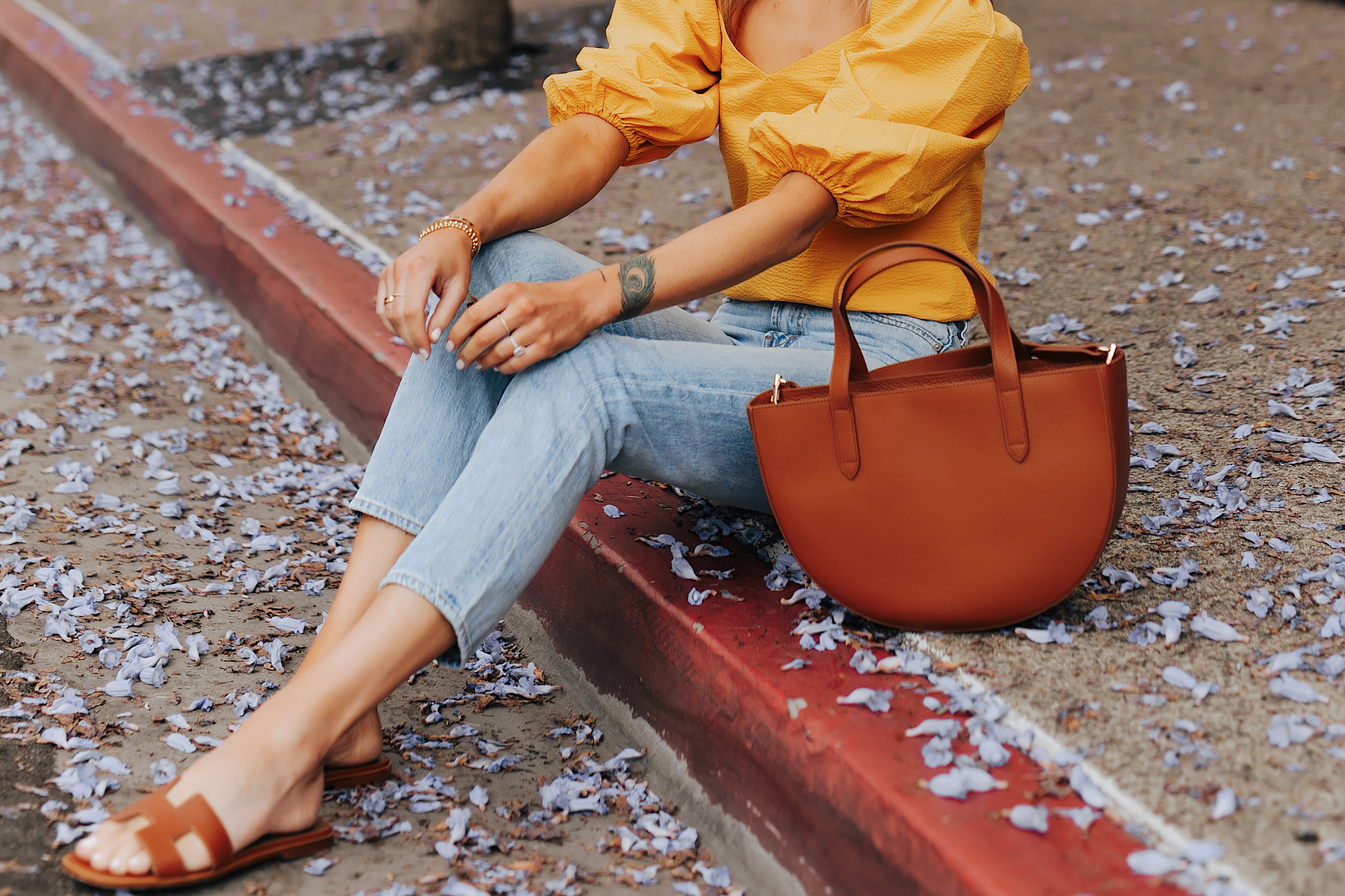 Fashion Jackson Wearing Cuyana Yellow Blouse Denim Ankle Jeans Hermes Oran Gold Sandals Cuyana Semi Circle Tan Handbag