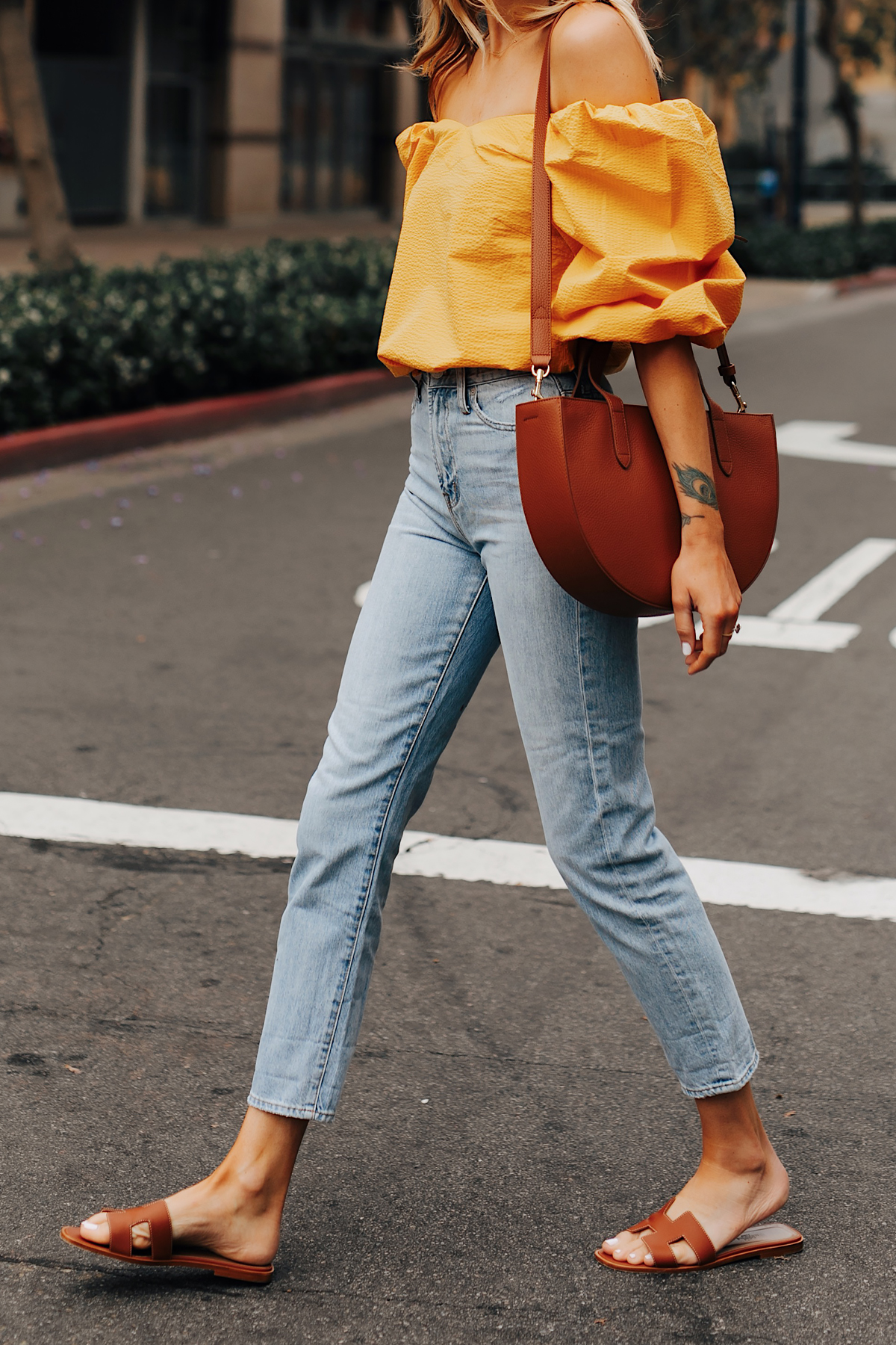 Fashion Jackson Wearing Cuyana Yellow Blouse Denim Ankle Jeans Hermes Oran Gold Sandals Cuyana Tan Handbag 1