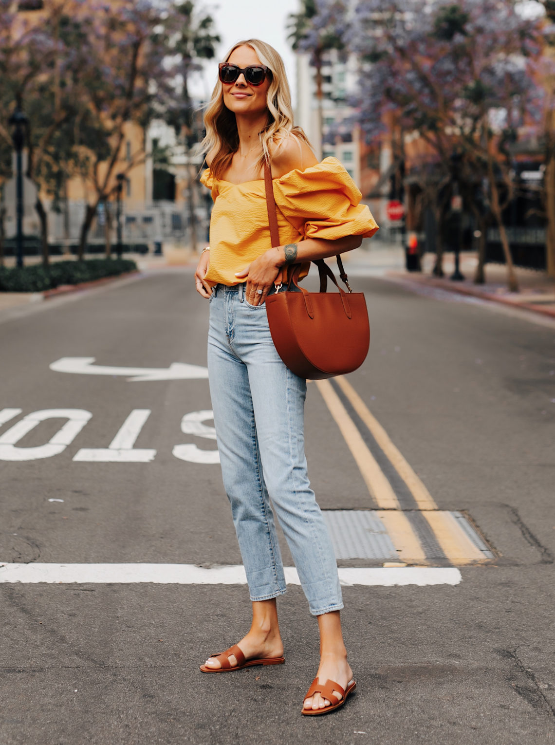 c4cd0971e9a Summer Styles Perfect for Your Next Vacation · Fashion Jackson Wearing Free  People Black Tshirt Boyish Ripped Jeans Black Block Heeled Sandals ...