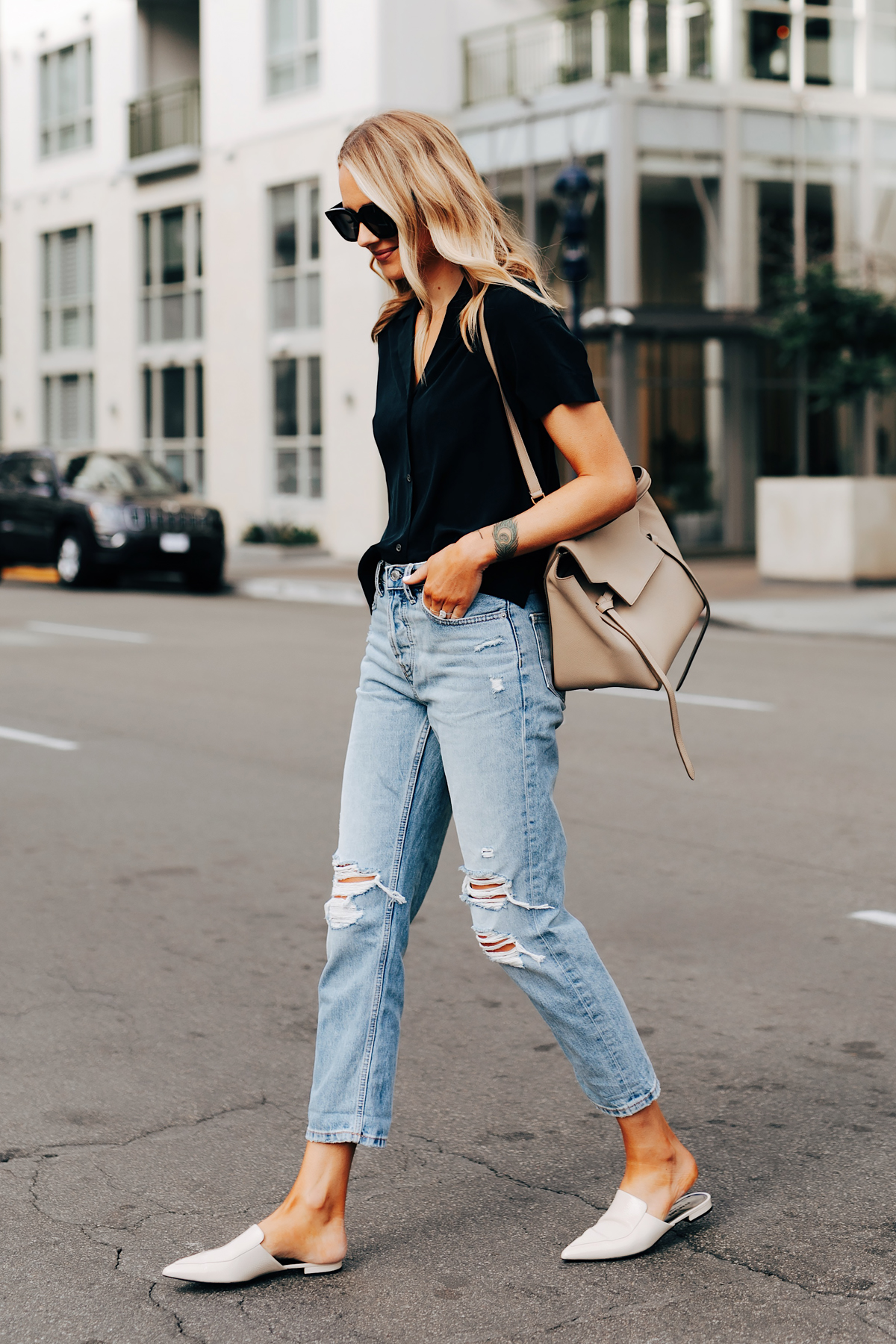 bdd3ca0fc52 Fashion Jackson Wearing Everlane Short Sleeve Black Top Everlane Ripped  Boyfriend Jeans Everlane White Mules Celine