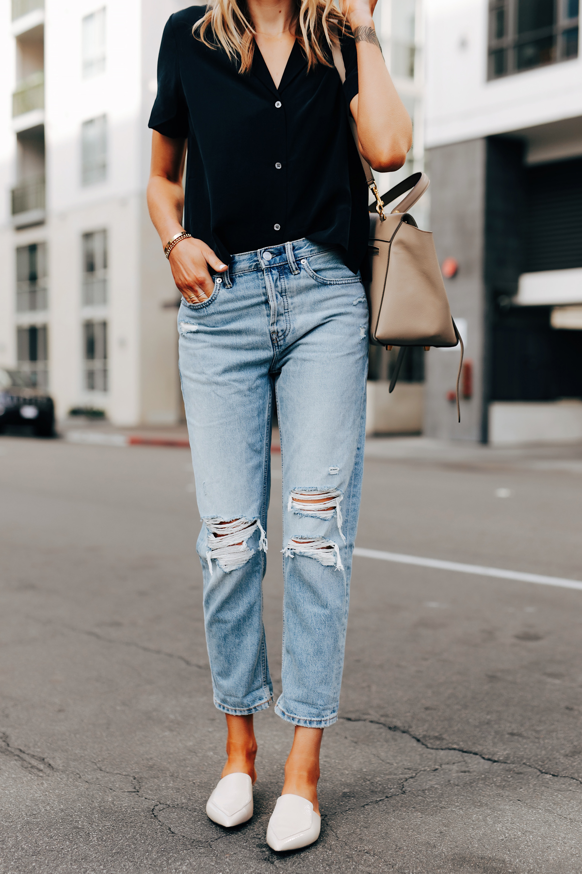 Fashion Jackson Wearing Everlane Short Sleeve Black Top Everlane Ripped Boyfriend Jeans White Mules
