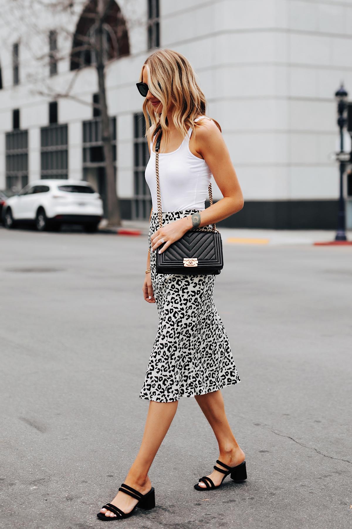 Fashion Jackson Wearing White Tank Leopard Midi Skirt Black Block Heel Sandals Chanel Black Boy Bag