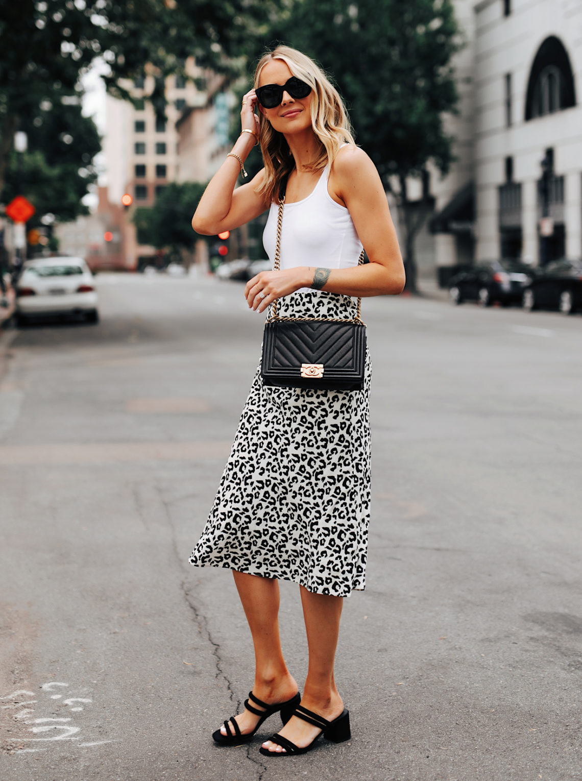 Fashion Jackson Wearing White Tank Leopard Midi Skrit Black Heeled Sandals Chanel Black Boy Bag Featured Image