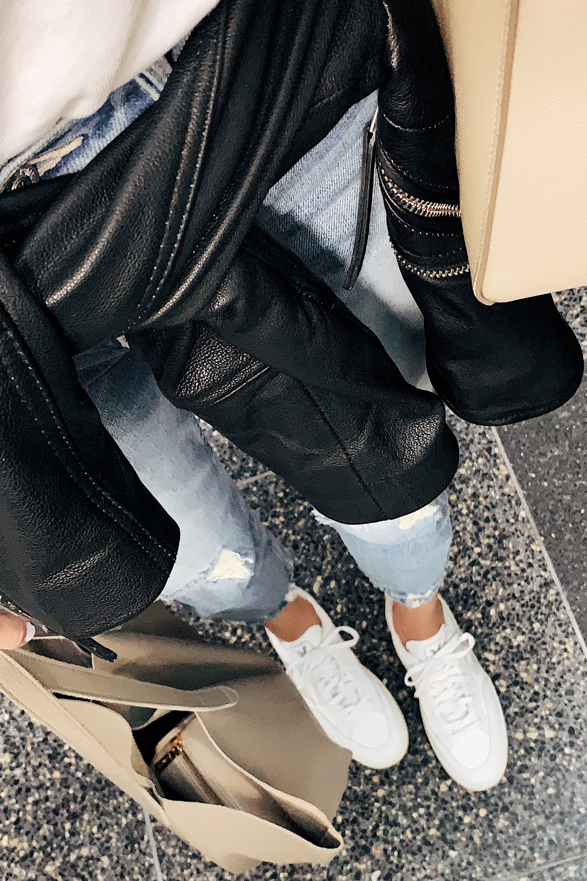 Fashion Jackson Airport Travel Outfit White Tshirt Black Leather Jacket Ripped Boyfriend Jeans Veja Sneakers Cuyana Tote