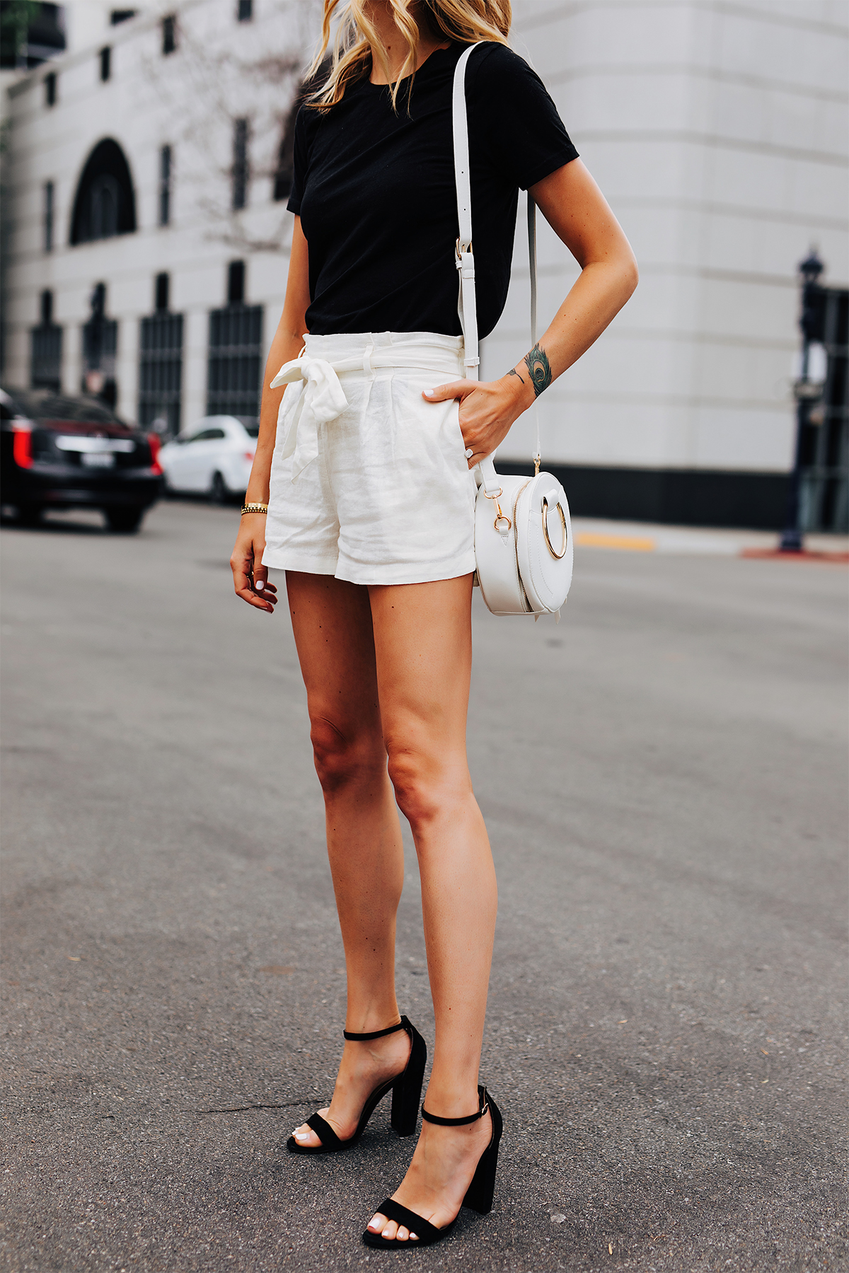 Fashion Jackson Wearing Black Tshirt White Tie Front Shorts Black Heeled Sandals White Circle Handbag