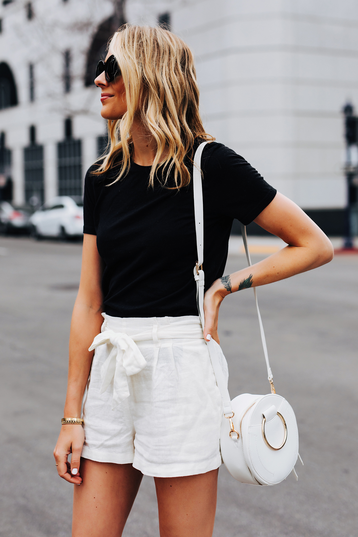 Fashion Jackson Wearing Black Tshirt White Tie Front Shorts White Circle Handbag 1