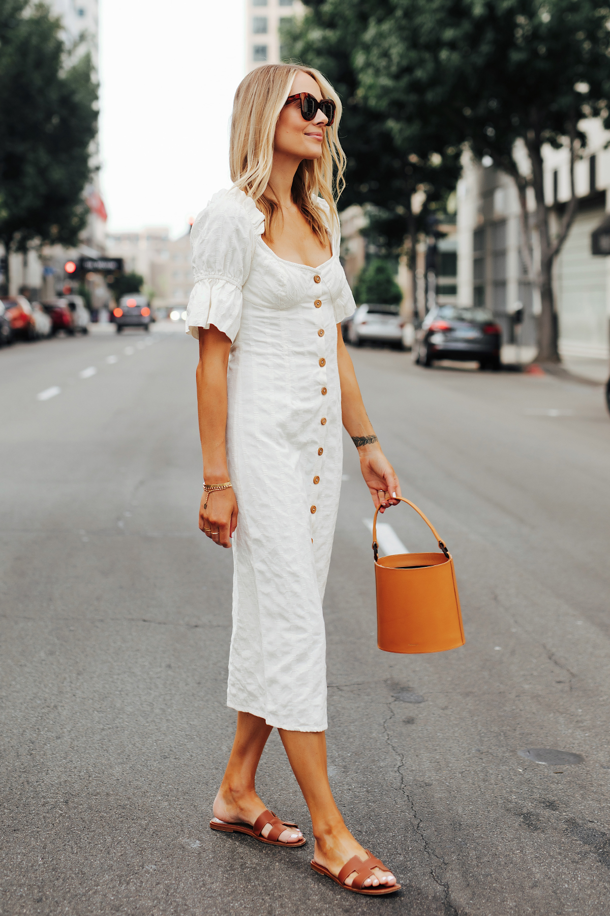 Fashion Jackson Wearing Free People White Off The Shoulder Button Front Midi Dress Tan Bucket Bag Hermes Oran Gold Sandals 1
