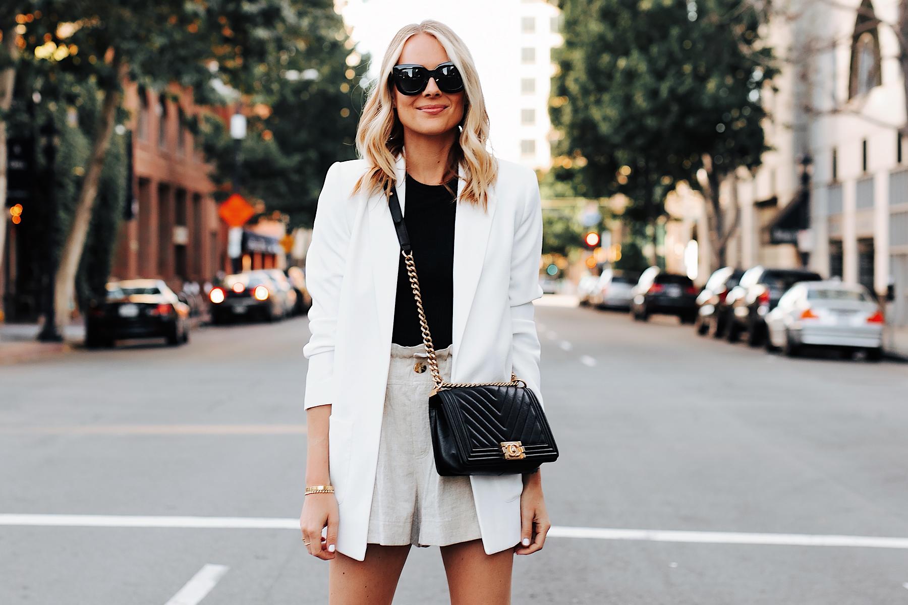 Fashion Jackson Wearing Long White Blazer Black Top Tan Linen Shorts Chanel Black Boy Bag 2
