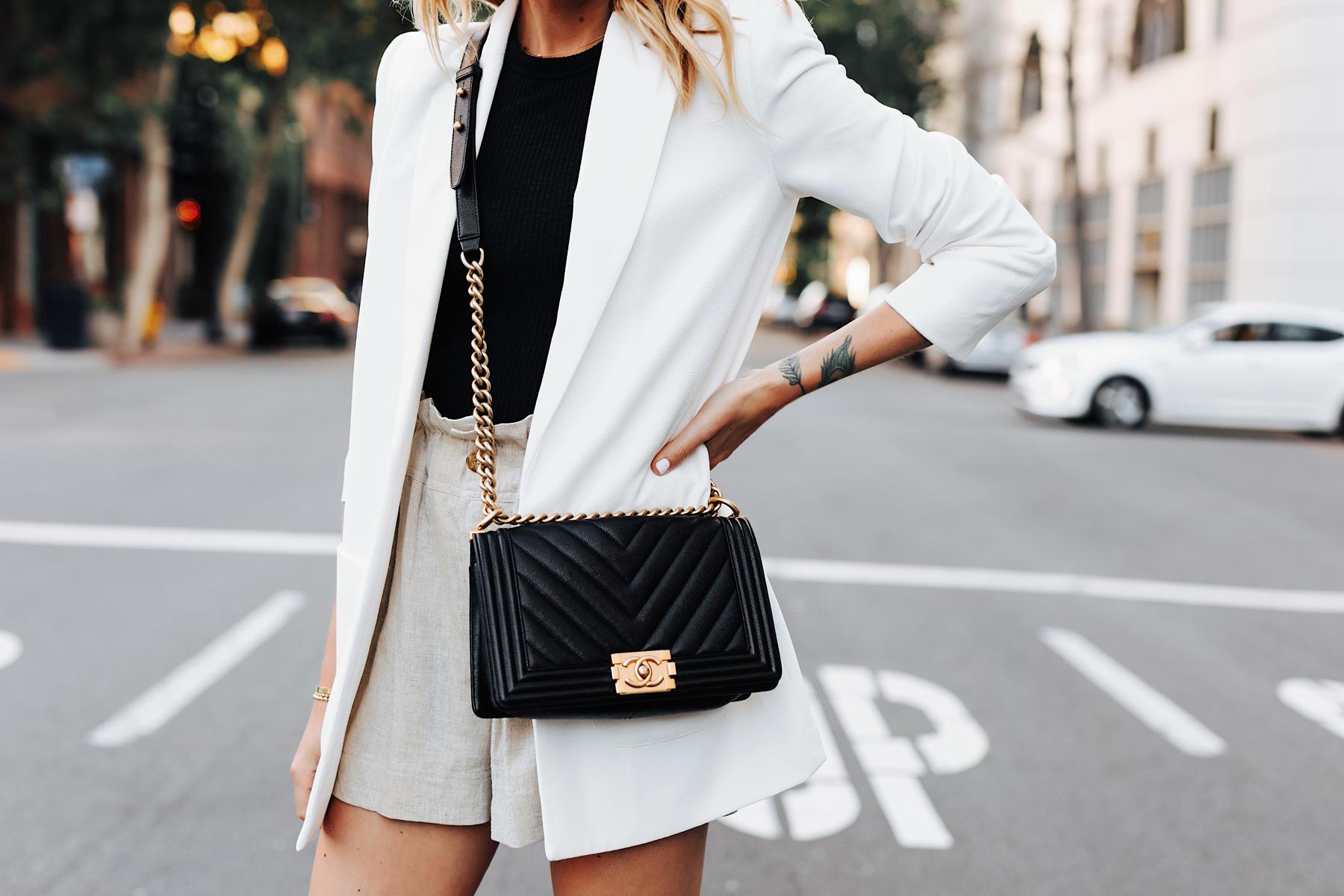 Fashion Jackson Wearing Long White Blazer Black Top Tan Linen Shorts Chanel Black Boy Bag