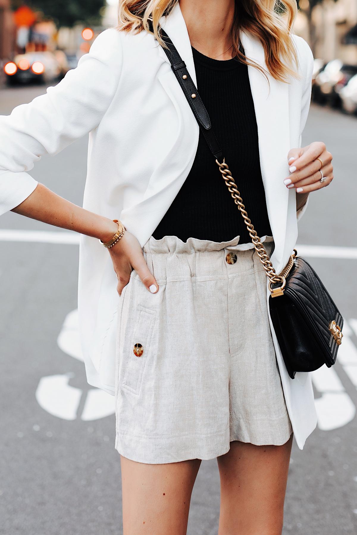 Fashion Jackson Wearing Long White Blazer Black Top Topshop Tan Linen Shorts Chanel Black Boy Bag
