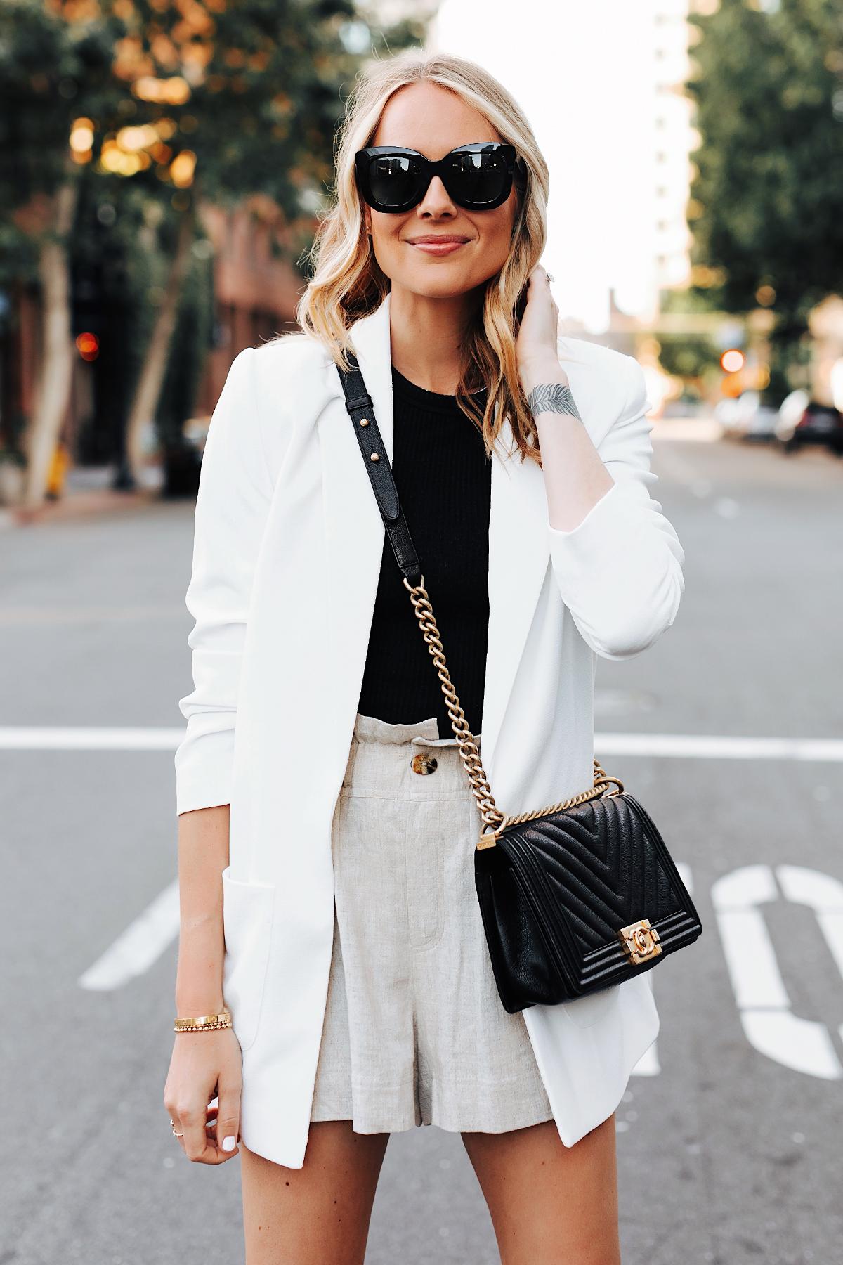 Fashion Jackson Wearing Nordstrom Long White Blazer Black Top Tan Linen Shorts Chanel Black Boy Bag