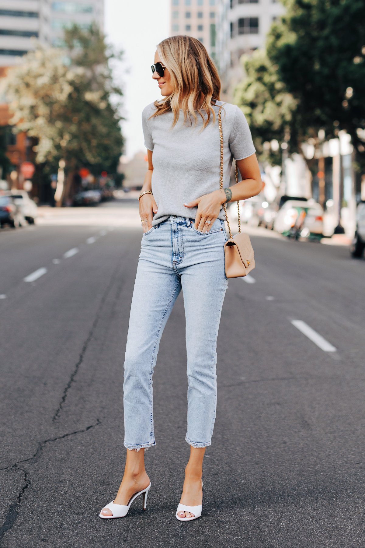 Fashion Jackson Wearing Theory Tolleree Short Sleeve Sweater Grey Abercrombie Straight Leg Jeans White Heels Chanel Beige Handbag 2