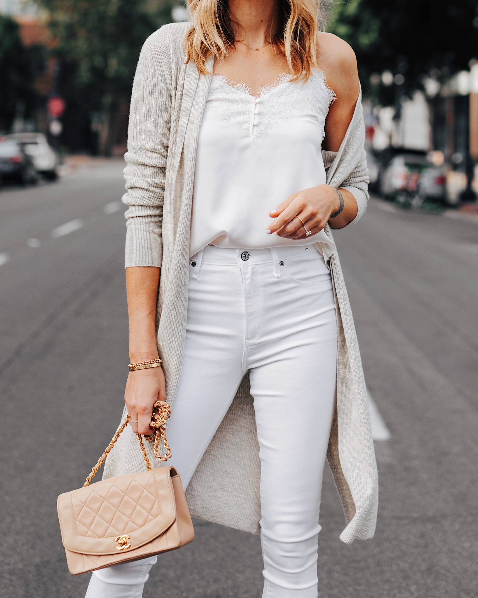 Fashion Jackson Wearing White Lace Cami Beige Cardigan White Skinny Jeans Tan Chanel Handbag