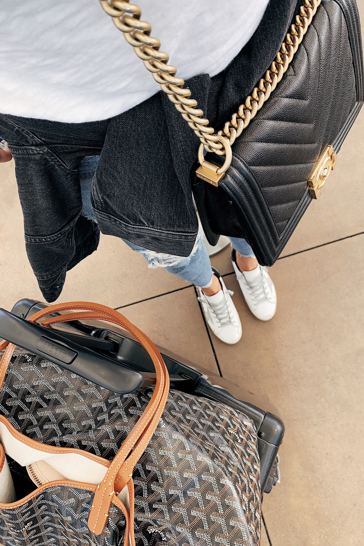 Fashion Jackson Travel Outfit Airport Style Chanel Black Boy Bag Goyard Tote Calpak Luggage