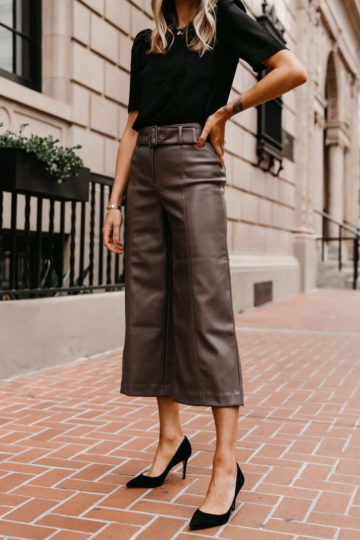 Fashion Jackson Wearing Ann Taylor Workwear Outfit Black Puff Sleeve Blouse Leather Pants Black Pumps Womens Workwear Attire 1