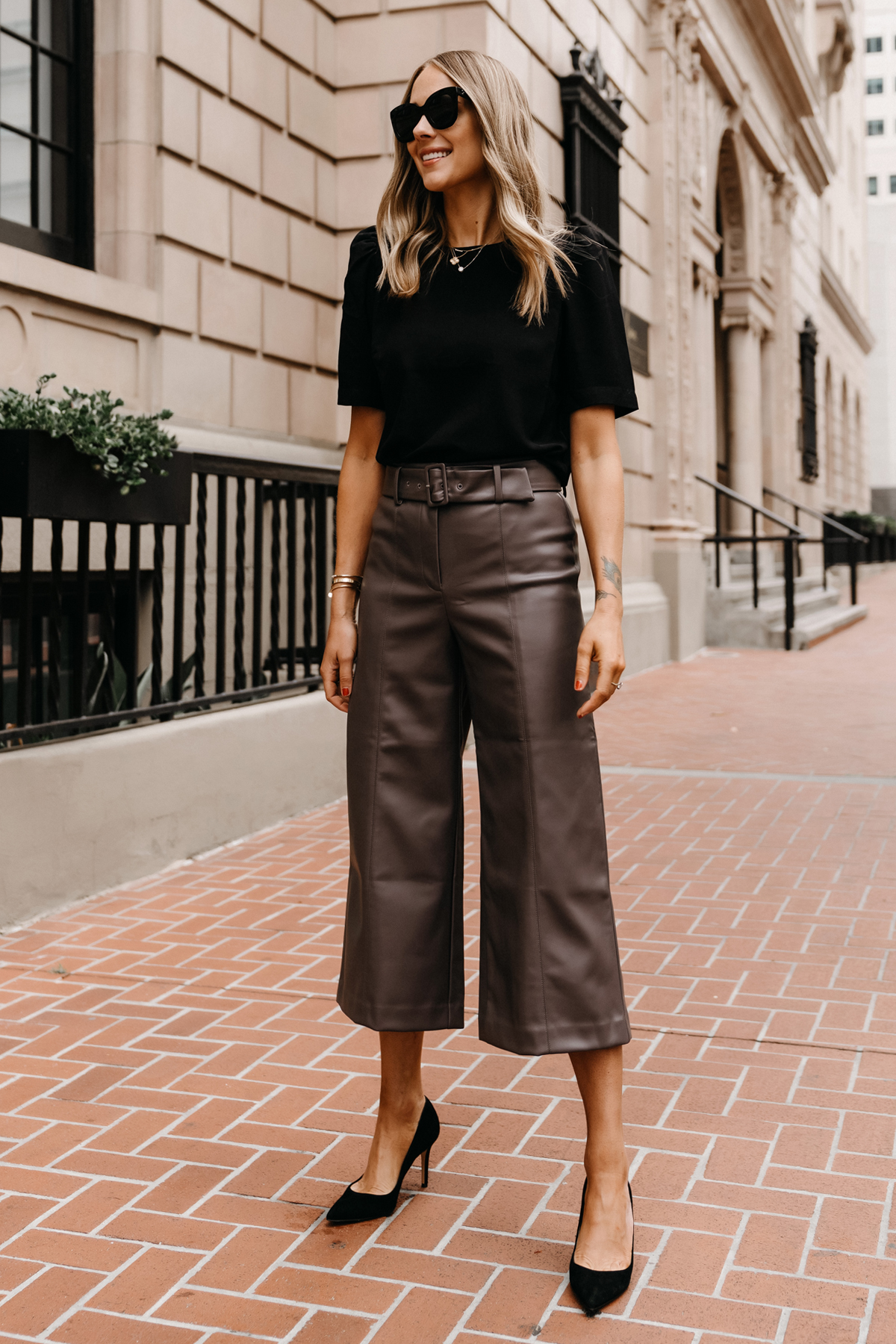 Fashion Jackson Wearing Ann Taylor Workwear Outfit Black Puff Sleeve Blouse Leather Pants Black Pumps Womens Workwear Attire