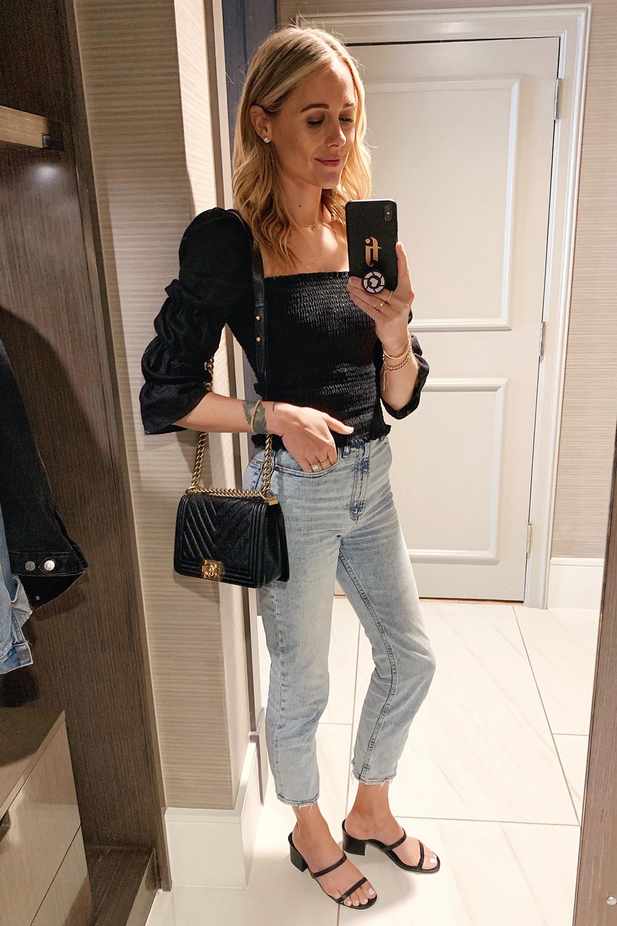 Fashion Jackson Wearing Black Smocked Blouse Denim Jeans Black Sandals Chanel Black Boy Bag