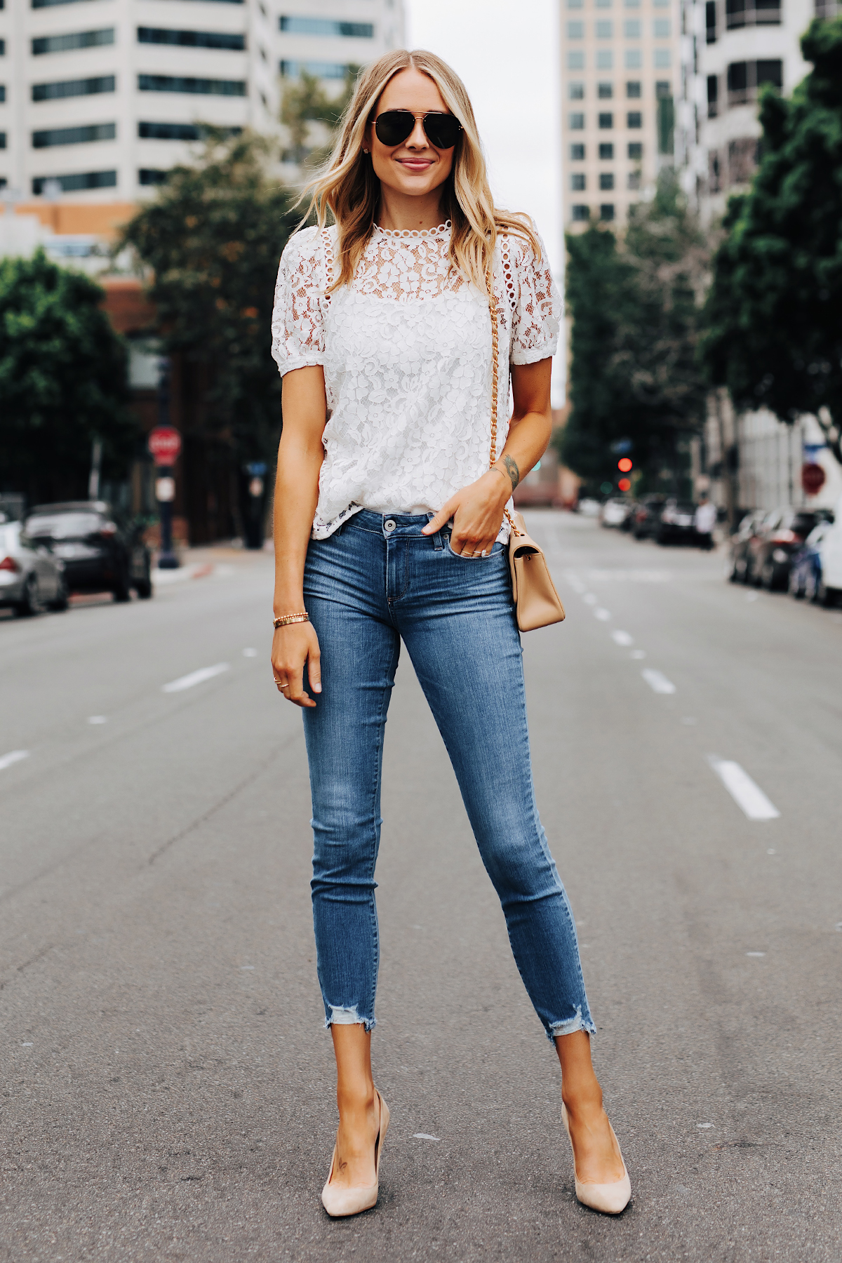 Fashion Jackson Wearing Bloomingdales Short Sleeve White Lace Top Paige Verdugo Skinny Jeans in North Star Distressed Jimmy Choo Nude BB Pumps Summer Date Night Outfit