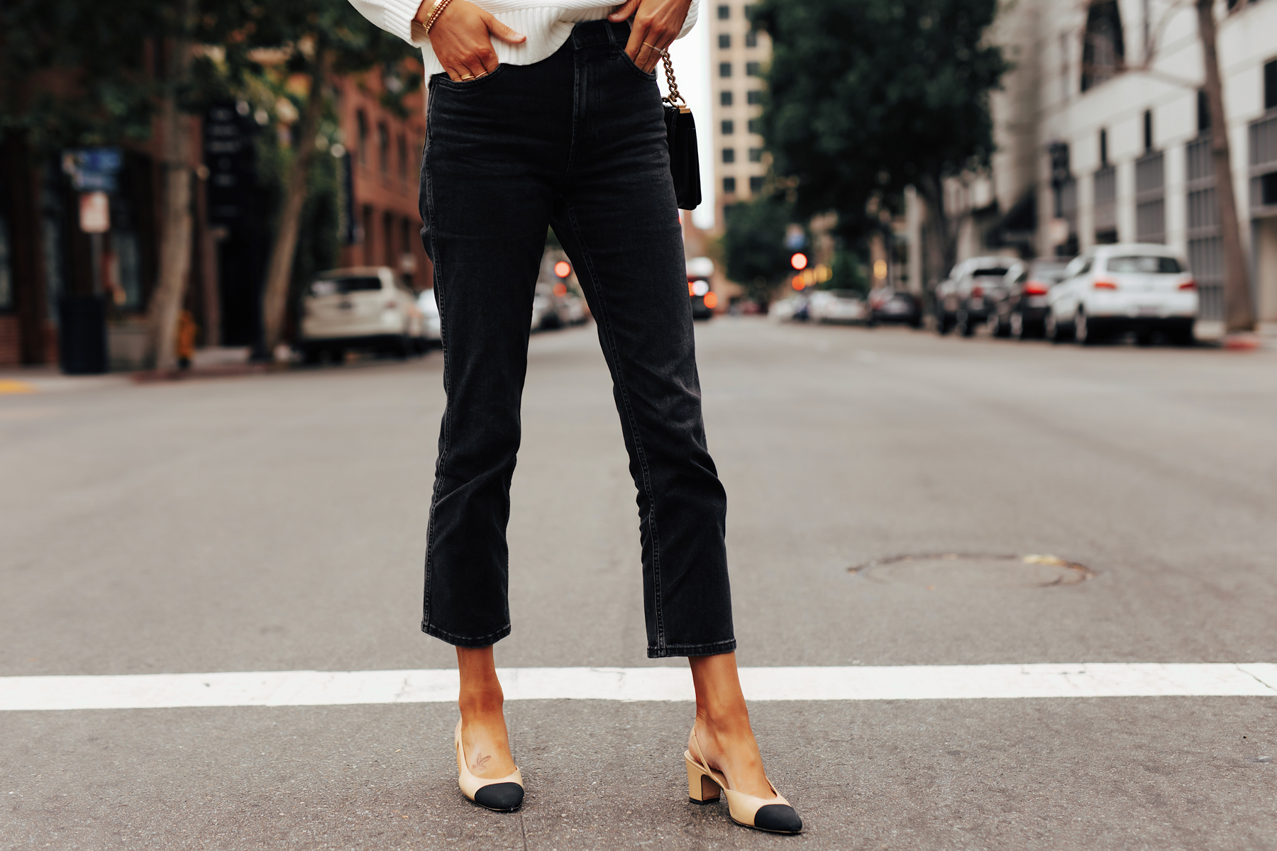 Fashion Jackson Wearing Everlane Cheeky Bootcut Ankle Jean in Black Chanel Slingbacks