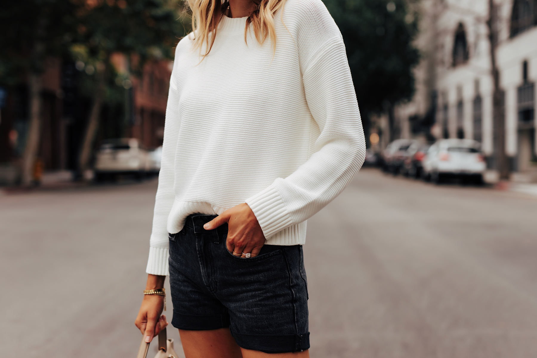 Fashion Jackson Wearing Everlane White Crewneck Linkstitch Sweater Everlane Black Denim Shorts