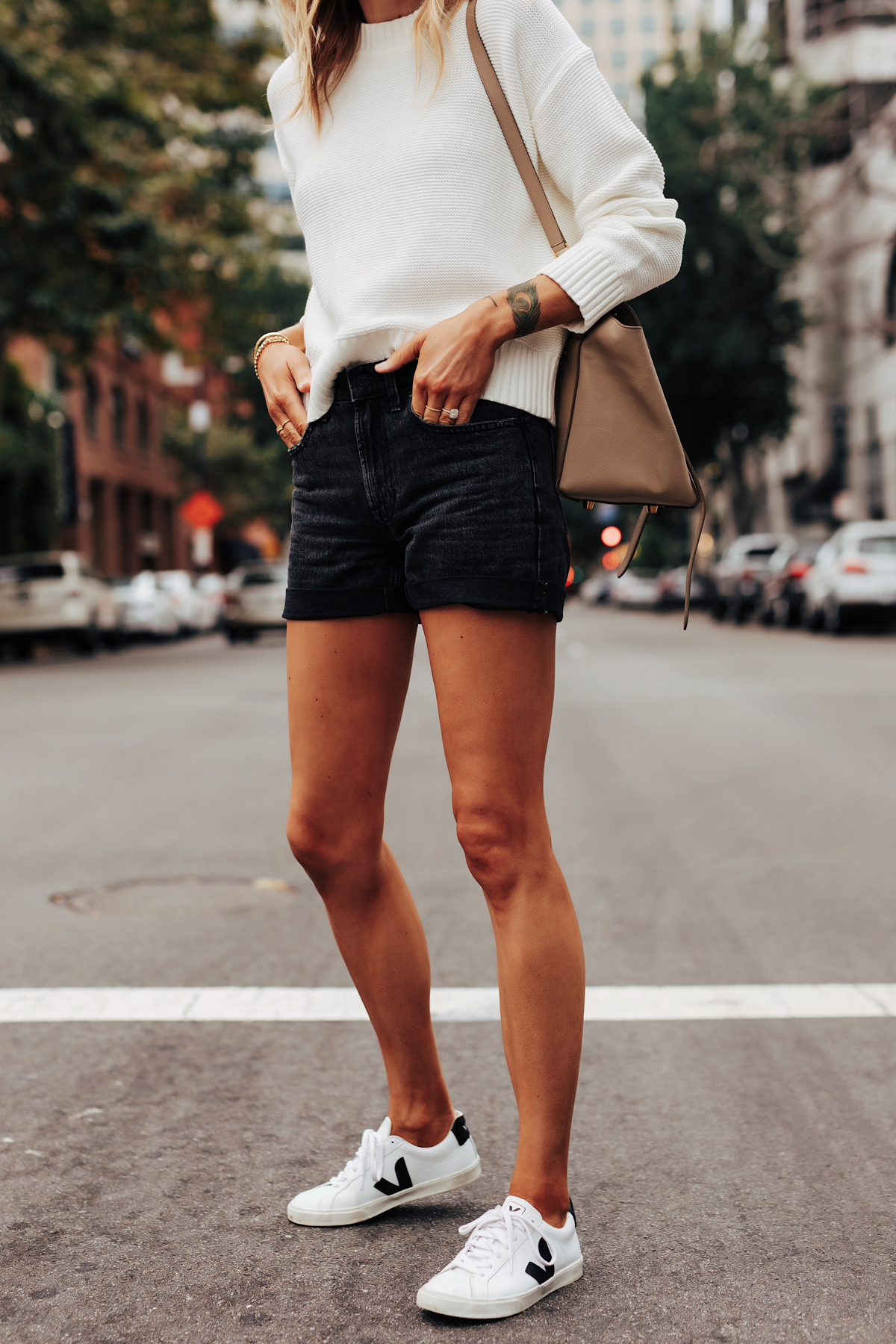 Fashion Jackson Wearing Everlane White Crewneck Sweater Everlane Black Denim Shorts Veja Esplar Sneakers 1
