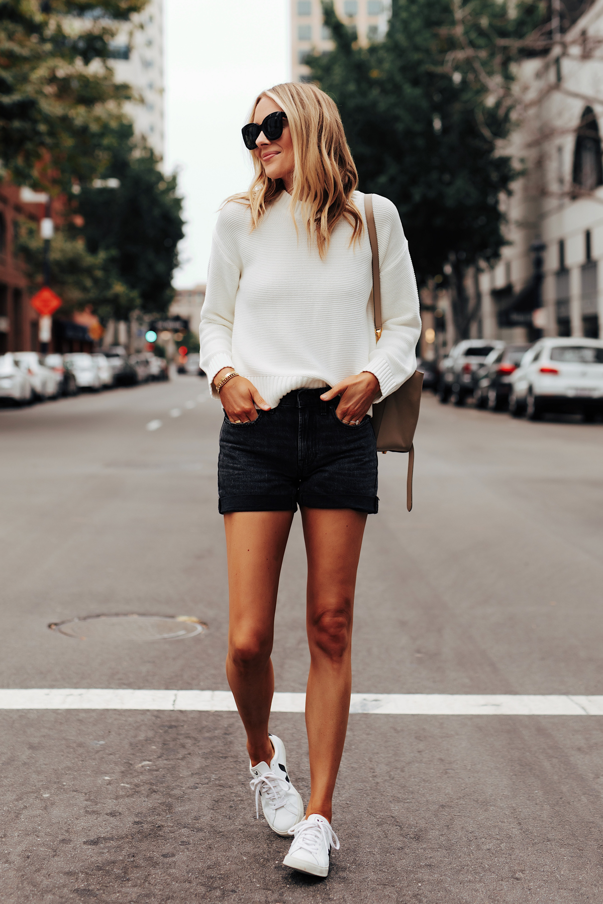 Fashion Jackson Wearing Everlane White Crewneck Sweater Everlane Black Denim Shorts Veja Esplar Sneakers