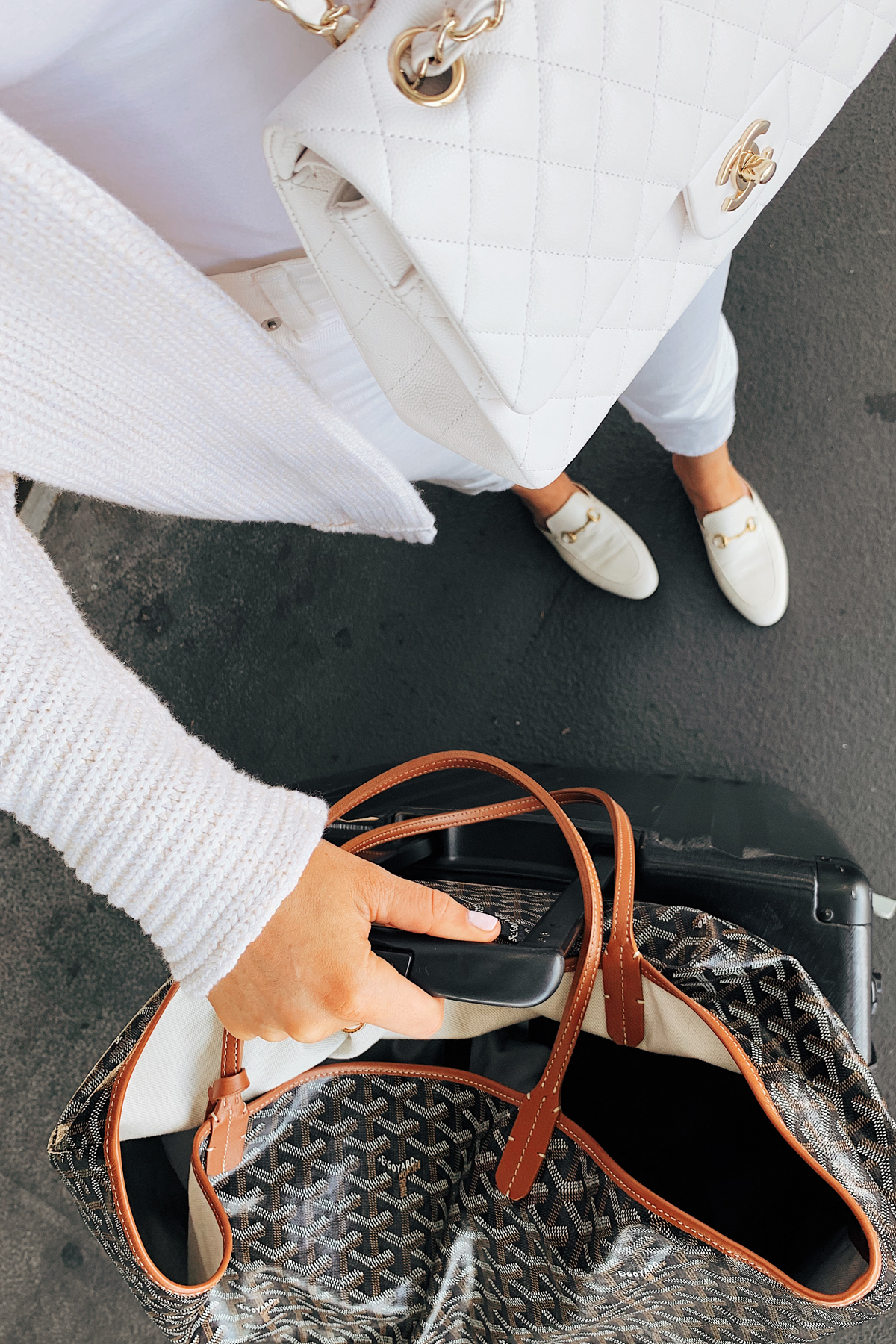 Fashion Jackson Wearing Free People White Tunic Sweater Levis High Rise Jeans White Gucci Muules White Chanel Handbag Calpak Luggage Goyard Tote Airport Outfit Travel Outfit 1