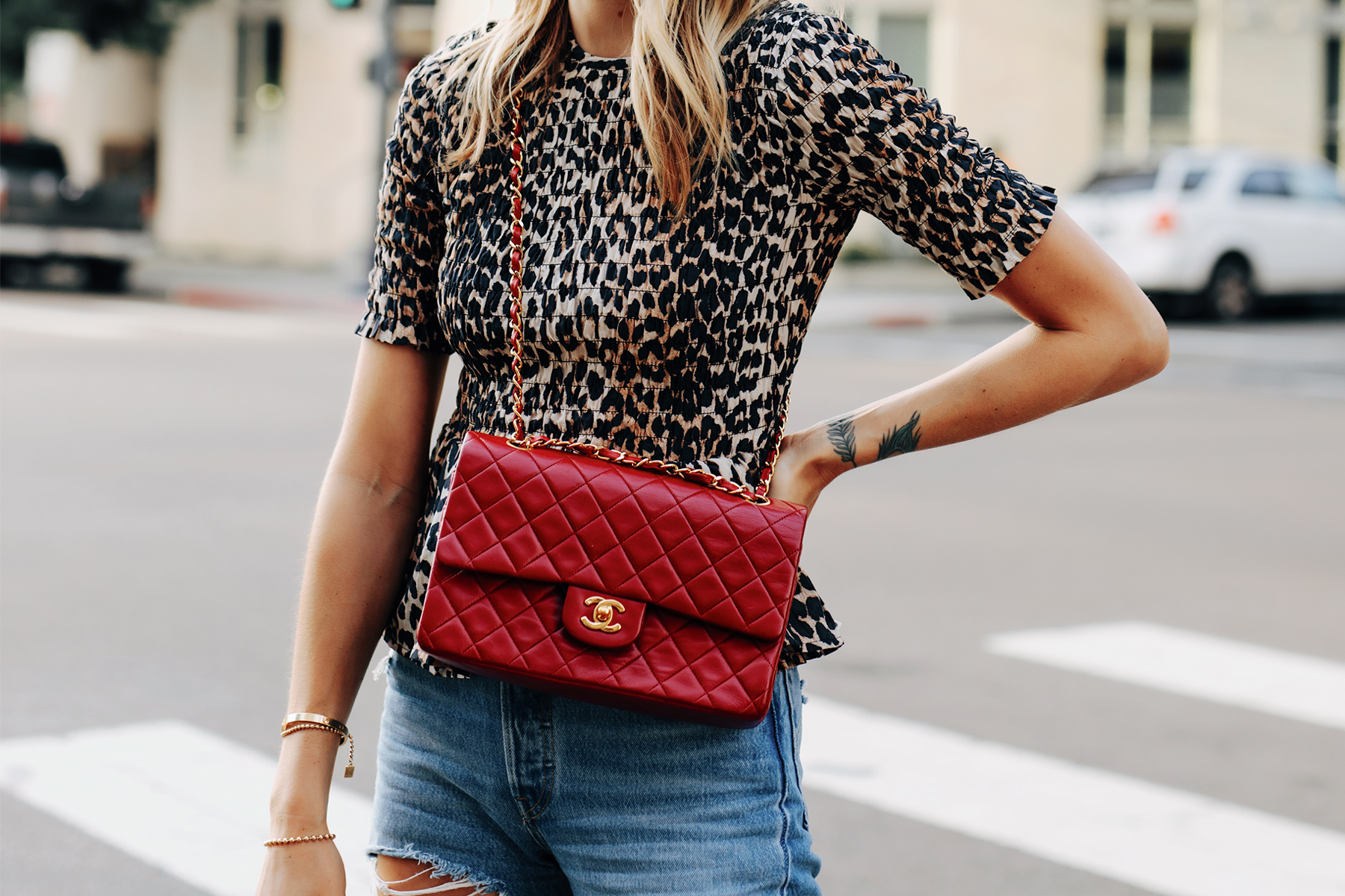 Fashion Jackson Wearing Ganni Leopard Peplum Top Chanel Classic Flap Red Handbag