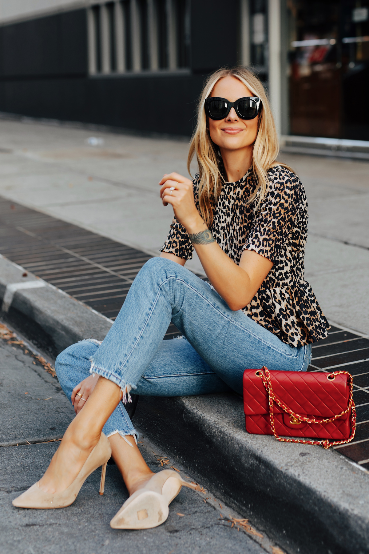 Fashion Jackson Wearing Ganni Leopard Peplum Top Levis Jeans Jimmy Choo BB Nude Pumps Chanel Classic Flap Red Handbag