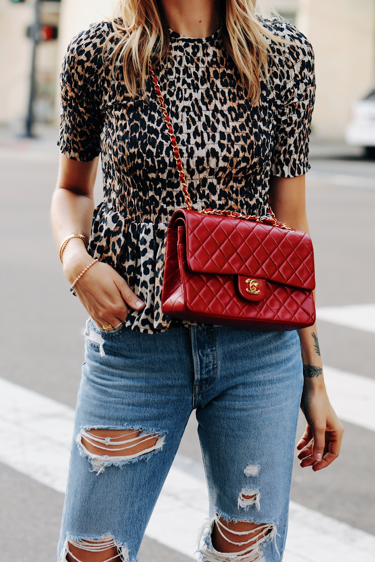 Fashion Jackson Wearing Ganni Leopard Peplum Top Levis Ripped Jeans Chanel Classic Flap Red Handbag