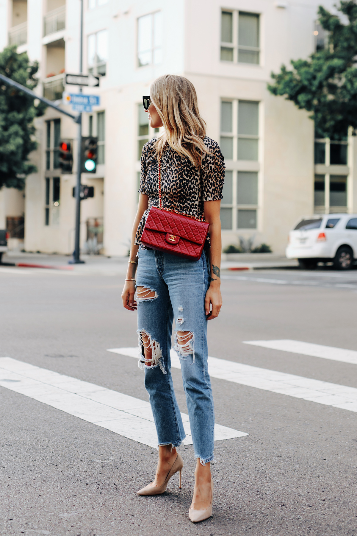 Fashion Jackson Wearing Ganni Leopard Peplum Top Levis Ripped Jeans Jimmy Choo BB Nude Pumps Chanel Classic Flap Red Handbag 1