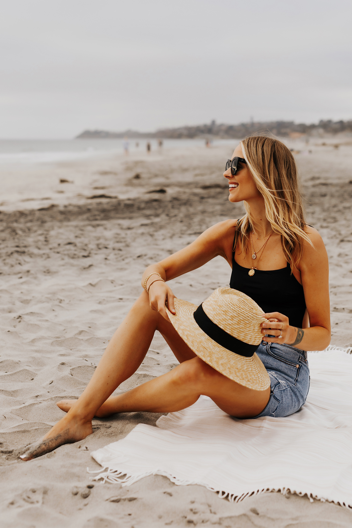 Fashion Jackson Wearing L Space Black One Piece Swimsuit Denim Shorts Brixton Straw Hat San Diego Beach Weekend