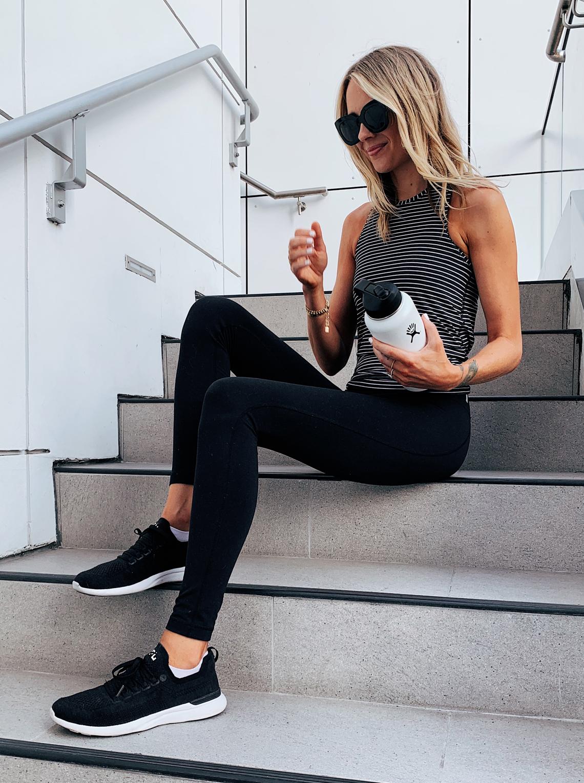 Fashion Jackson Wearing Lululemon Black White Stripe Tank Black Leggings APL sneakers White Hydroflask