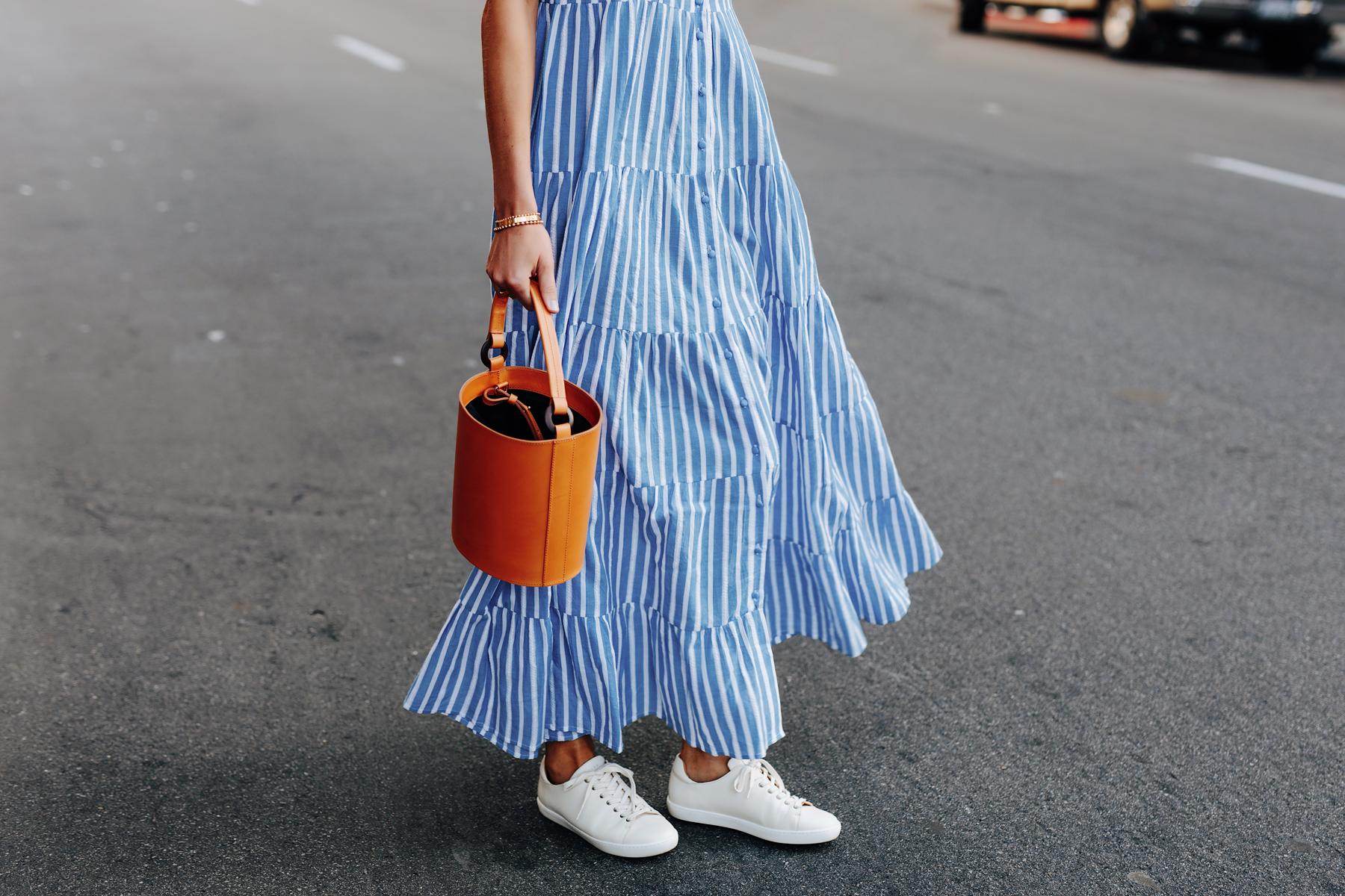 Fashion Jackson Wearing Sezane Blue White Stripe Maxi Dress White Sneakers Cognac Bucket Bag 1