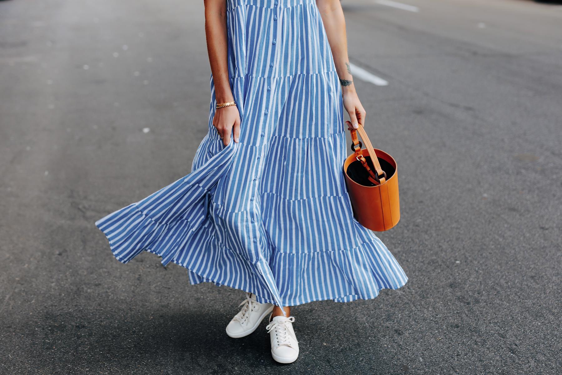 Fashion Jackson Wearing Sezane Blue White Stripe Maxi Dress White Sneakers Cognac Bucket Bag 2