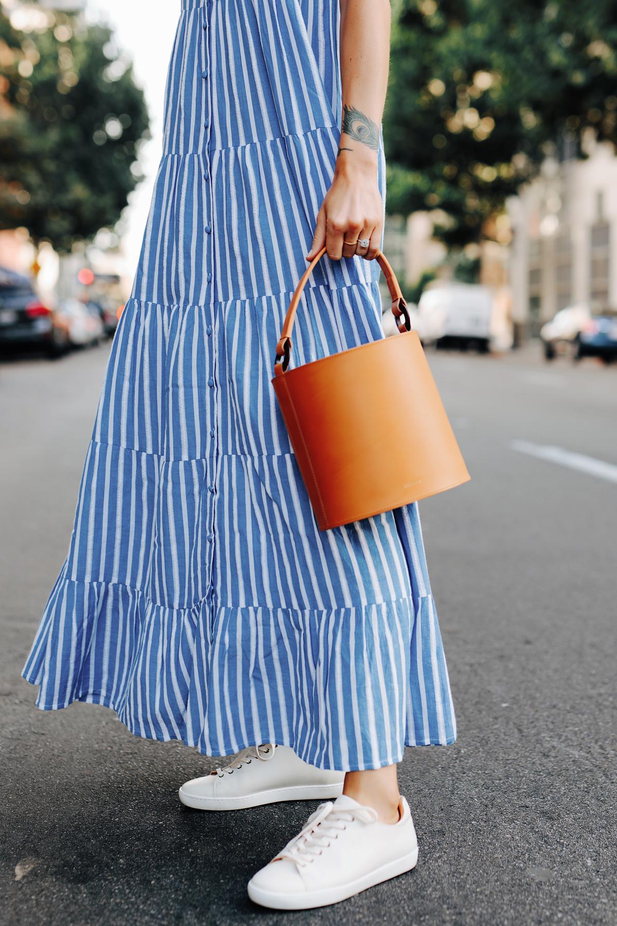 Fashion Jackson Wearing Sezane Blue White Stripe Maxi Dress White Sneakers Cognac Bucket Bag 3